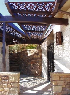 A beautiful patio or deck shade in a unique backyard or walkway in Flanigan design by Parasoleil.