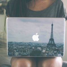 Paris MacBook Skin / The Apple logo now seems to be an evident object visible from the Paris skyline as you cover your Macbook with this Paris MacBook Skin. http://thegadgetflow.com/portfolio/paris-macbook-skin/