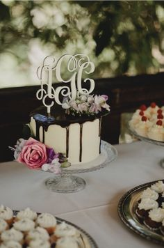 A small cake can be eye-catching with a monogram cake topper.