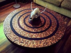 Round Penny table created from a wagon wheel.