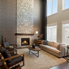 Stone fireplace in a #morrisonhomes showhome. The textured wall paper really helps complete this look.