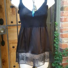 Black Tank Black on black on black! The bodice is knit, the middle part is a satin - like  material the bottom is trimmed with a sheer tulle. Good condition. Cynthia Steffe Tops Tank Tops
