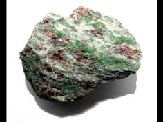 """Eclogite, the """"Christmas tree rock"""": Garnet (red-brown), Omphacite (green) and Quartz (white)/ Almenning, Norway Christmas Party Venues, Christmas Rock, Christmas Tree, Cool Rocks, White Quartz, Red Garnet, Rocks And Minerals, Stones And Crystals, Norway"""