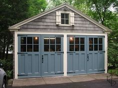 See pictures of our finished doors in our photo gallery. Hinged carriage house garage doors that open and swing out. Evergreen Carriage Doors builds custom hand crafted authentic carriage house doors and carriage garage doors. Design Exterior, Exterior Paint Colors, Exterior House Colors, Exterior Shutters, Diy Exterior, Garage Exterior, Paint Colours, Colonial Exterior, Blue Shutters
