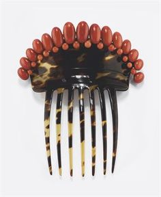 Tortoise and Coral hair comb, 19th Century.  Sold at Christies in Milan, 2010