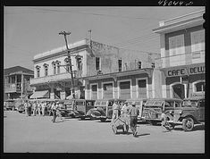 """Arecibo, Puerto Rico. A row of station wagons or """"publicos"""" waiting for loads and passengers"""