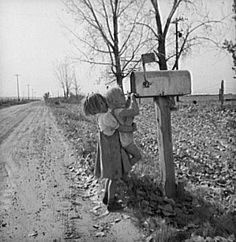 Children check the mail in rural Idaho, 1939.  By Dorothea Lange.