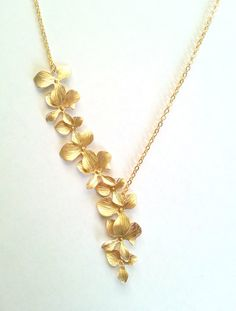 Gold Cascading Orchid Necklace Assymetrical by CorinnaMaggyDesigns