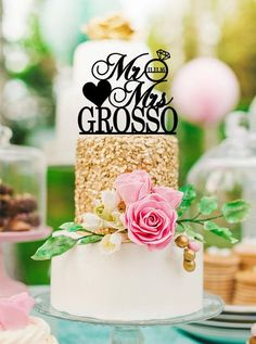 """This personalized wedding cake topper is made in glitter or rustic wood for a beautiful way to adorn your wedding cake! The custom created cake topper includes """"Mr&Mrs"""" plus your last name and wedding"""