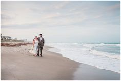Couple walking arm in arm by ocean during Cocoa Beach Wedding
