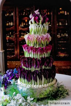 flowers on a wedding cake. i can't tell if i love this or hate it.