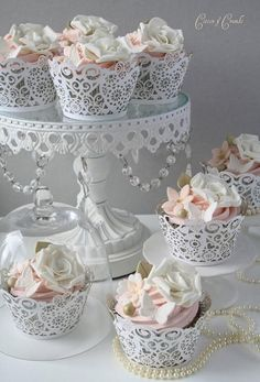 Weddbook ♥ Frilly wedding cupcake wrappers. Gorgeous white lace wedding cupcakes with edible sugar flowers and butterflies. Bridal / wedding shower or tea part cupcake ideas. Creative cupcake designs.. lace butterfly spring summer vintage stand pearl cupcake white gift