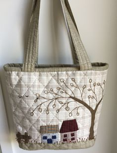 Recently finished this is an a needle turn applique houses bag with traditional hand quilting and zippered top closure.
