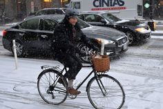 © Mladen Antonov/AFP/Getty Images A man rides a bicycle on a street in downtown Washington, DC during a wet snow January 6, 2015. The first significant snowfall of the year wrecked havoc on the morning rush hour in the Washington, DC area.