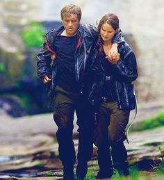 Hunger Games still: on their way to the cave