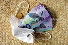 New Zealand Money (NZD) Dollars with Face Mask A mixture of New Zealand Bank notes with a face mask on a woven kete background. This image is for a Healthcare & Finance Concept. All Australasian Currencies Stock Photo Image Now, New Image, Bank Financial, Video New, Feature Film, Photo Illustration, Royalty Free Images, New Zealand, Finance