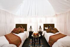 A tented hotel in the middle of the desert. Considering the hostile environment these well-equipped refuges provide surprisingly good facilities for comfort and relaxation.