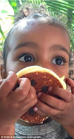 Sweet tooth: Kim Kardashian shared an adorable before and after photo of hear daughter North enjoying a chocolate pancake