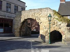 Newport Arch, Lincoln. One of the few remaining Roman arched gates in the UK, that were originally connected to the city walls. You can see here that the ground surface is much higher than in Roman days. People would have walked under the small arch (which you can still do) but you wouldn't have been able to touch the ceiling.