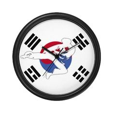A Tae Kwon Do male Martial Artist flying across a background of the korean flag. Perfect for a Tae Kwon Do classroom or instructor's office.
