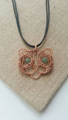 Check out this item in my Etsy shop https://www.etsy.com/listing/269838576/aventurine-and-upcycled-copper-panda