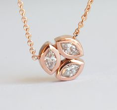 Elegant genuine diamond necklace with three marquise diamonds set in round shape. Classic necklace for everyday wear. Total carat weight is 0.3 carat. Necklace can be made in 14/18k rose, yellow or white gold. Item info: 14 or 18k solid gold marquise diamonds - total carat weight 0.3 carat,