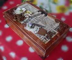 5. wooden box, decorated with scrapbook paper, acrylic paints and metal ornaments