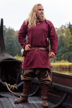 Great looking, comfortable red Viking Age tunic made from dense, durable wool. Based on historical sources. Historically accurate gores on the sides. 100% wool. The tunic is made from recycled wool that is a great ECO-friendly option! Aided by modern-day quality controls and meticulous sorting before shredding and weaving, it saves on the energy and water needed to produce non-recycled wool. The process also eliminates the use of chemicals. #grimfrost Viking Tunic, Viking Garb, Viking Men, Viking Warrior, Concept Clothing, Armor Clothing, Viking Clothing, Historical Clothing, Vikings