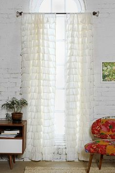 Waterfall Ruffle Curtain - Urban Outfitters- we definitely need curtains to make the room look homey if our building allows it!
