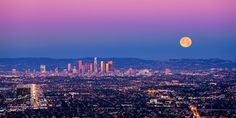 Colorful full moon on the rise at sunset in Los Angeles