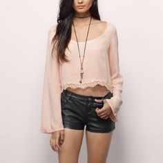 NWT Adelisa cropped top Peach/blush bell sleeve crop blouse with lace trim. Fits true to size, pairs well with jeans or shorts! Great for a boho festival look. The price is firm on this item because it's still on their website for $34 and I think I'm cutting a great deal since it's brand new with tags & never been worn! Tobi Tops Crop Tops