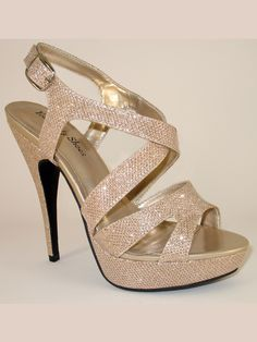 """Crafted with rich sequined material and metallic faux leather insole, this strappy prom sandal adds formal allure to your ensemble. Your Party Shoes Natalie 306 features a 3 1/2"""" stiletto heel and 1"""" platform giving support to the open toe front. The criss crossing straps are wide as the back offers a buckle sling back. Features: Style: Platform Sandal Heel Height: 3 1/2"""" Material: Sequined Faux Leather Sizes Available: 5.0 through 11 Colors Available: Silver, Nude TRUE FIT GUARANTEE FE..."""