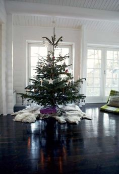 Cowhide Christmas tree skirt. (Forget the skirt i love the floors for 2R!)