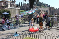 A street performer blows #bubbles during a presentation next to the #RomanForum