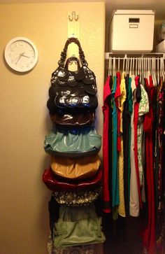 Purse Rack DIY. Buy a long, wood board. Screw hooks on sideways. Easy, organized, bag storage.