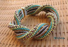 Here's a wide twisted bead crochet cuff from Dora. Is the twist built in?