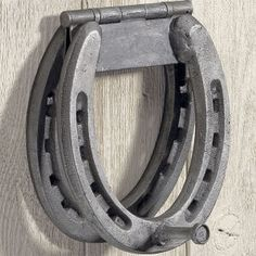 horse shoe knocker, Jake needs to make this!  You could use a lot of different things for the knocker...the clue is the hinge!