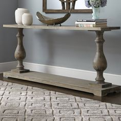 Arrange framed photos and stacked art books on this essential table, perfect accenting your living room or parlor ensemble.
