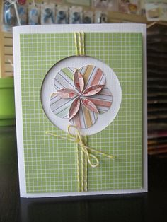 handmade card ...  circle flower with folded overlapping edges ... luv how the bottom layer of the two sided patterned paper appears and makes a second flower shape ...  Baker's Twine wrapped around the space between the negative space circle and the edge of the main panel ... luv this card!!