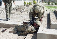 An american soldier helps this other soldier after an attack in Kabul, Afganistan. The real world people!!