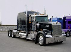 A Kenworth W900 with sleeper cab, one of these with a Caterpillar 'King Of The Hill' engine hauls the Juggernaut.