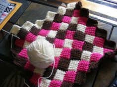 I've tried to figure out how to do this before, and I just couldn't get it! I think it's tunisian crochet.