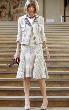 Wear a matching skirt and jacket ensemble as approved by Anna Wintour. Just remember lighter colors look more classy and less severe.