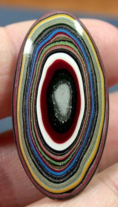 "Solid Fordite Cabochon RAINBOW OVAL (suzybones)  This is a ""manmade"" stone. Fordite is actually the leftover paint drops from cars when they were painted in the manufacturing plant. They have beautiful colors and patterns!"