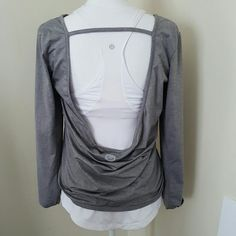 Roxy open back tee Like new! Roxy long sleeve open back tee, poly/spandex blend. Very soft and smooth! Heather grey. Great for yoga, pilates, dance!  White Lululemon shirt also in pic has been sold.  Low balls ignored. No trades. Roxy Tops Tees - Long Sleeve