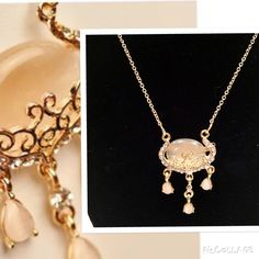 """Fall BOGO 50% Off Sale  Beautiful gold tone ornate setting with a stunning cream colored ellipsoid center stone. Ornate scroll style setting with clear crystal surrounding detail. Three tear drop style matching stone add a flirty feminine style to this piece. Includes attached gold tone chain. Measures approx 18"""" in length. Jewelry Necklaces"""