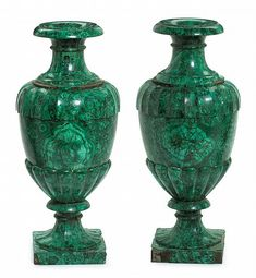 "Important pair of Russian malachite urns imperial lapidary factory, ekaterinburg, signed and dated 1862 Each in three sections, the everted rim over detachable collar, the body with fluted shoulder and lobed base, on conforming fluted socle and square base, the underside of each inscribed in ink in cyrillic ""Ekaterinburg, M.N. Krasnikov, 1862 March 1st"". (2). H: 27, D: 13 in."
