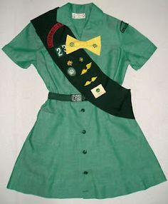 Girl Scout Uniform...looks just like mine!  That hideous yellow bow!