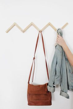 DIY crafts to make and sell on etsy. 14 DIY Crafts to Make and Sell on Etsy: I always need extra money! Making trending crafts. Diy Coat Hooks, Diy Coat Rack, Coat Racks, Zig Zag Shelf, Trending Crafts, Plaid Tablecloth, Store Interiors, Garment Racks, Crafts To Make And Sell