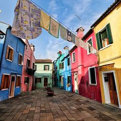 BURANO ISLAND   VENICE   ITALY  ▪▪▪▪▪▪▪▪▪▪▪▪▪  Photo from @merco75!  ▪▪▪▪▪▪▪▪▪  Burano's traditional industry is fishing and used to be its biggest business. As a result, there were lots of fishing boats sailing in and out of its harbour on fishing expeditions.  Legend has it that population began painting their homes luminous colours so that the fishermen could see them even in thick fog and avoid crashing into the shore after a voyage at sea.